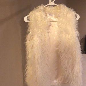 White furry vest